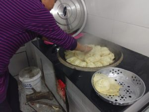 dumplings on rocket stove - shaoyingtours.com
